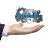 gears with the text wordpress over a businessman hand